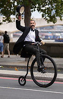 Penny farthing rider along the Victoria Embankment. The Prudential RideLondon FreeCycle. Saturday 28th July 2018<br /> <br /> Photo: Ian Walton for Prudential RideLondon<br /> <br /> Prudential RideLondon is the world's greatest festival of cycling, involving 100,000+ cyclists - from Olympic champions to a free family fun ride - riding in events over closed roads in London and Surrey over the weekend of 28th and 29th July 2018<br /> <br /> See www.PrudentialRideLondon.co.uk for more.<br /> <br /> For further information: media@londonmarathonevents.co.uk