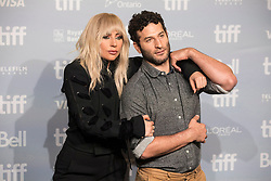 """Lady Gaga gestures as she leaves a photo call before appearing at the press conference for """"Gaga: Five Foot Two"""" at the Toronto International Film Festival, in Toronto on Friday, September 8, 2017. Photo by Chris Young/Canadian Press /ABACAPRESS.COM"""