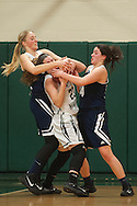 Burlington's Norah Mitchell (14) and Riley Janeway (31) battle for the ball with Rice's Anya Brown (23) during the girls basketball game between the Burlington Sea Horses and the Rice Green knights at Rice Memorial high school on Thursday night February 18, 2016 in South Burlington. (BRIAN JENKINS/for the FREE PRESS)