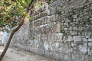 Ancient wall, 4th - 3rd century BC, Butrint, Chaonia, Albania. Butrint was founded by the Greek Chaonian tribe and was a port throughout Hellenistic and Roman times, when it was known as Buthrotum. It was ruled by the Byzantines and the Venetians and finally abandoned in the Middle Ages. The ruins at Butrint were listed as a UNESCO World Heritage Site in 1992. Picture by Manuel Cohen