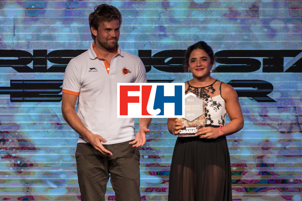 CHANDIGARH, INDIA - FEBRUARY 23: Moritz Fuerste [L], FIH Athletes Committee Representative presents the FIH Female Rising Star of the Year award to Maria Granatto [R] of Argentina during the FIH Hockey Stars Awards 2016 at Lalit Hotel on February 23, 2017 in Chandigarh, India. (Photo by Ali Bharmal/Getty Images for FIH)