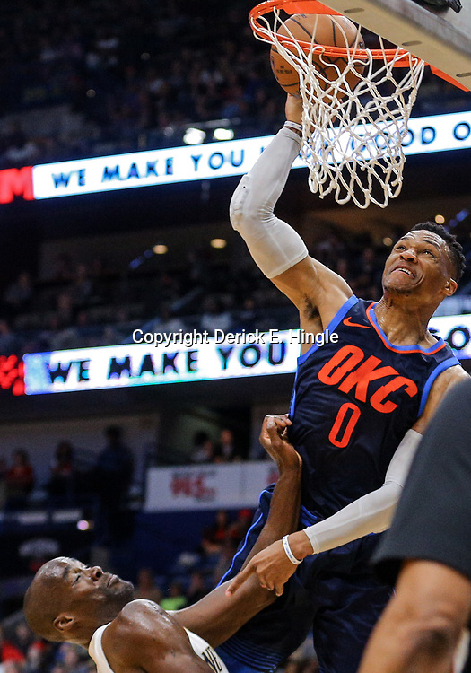 Apr 1, 2018; New Orleans, LA, USA; Oklahoma City Thunder guard Russell Westbrook (0) misses a dunk as New Orleans Pelicans center Emeka Okafor (50) defends during the first quarter at the Smoothie King Center. Mandatory Credit: Derick E. Hingle-USA TODAY Sports