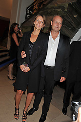 SAFFRON ALDRIDGE and IAN WACE at The Global Party held at The Natural History Museum, Cromwell Road, London on 8th September 2011.