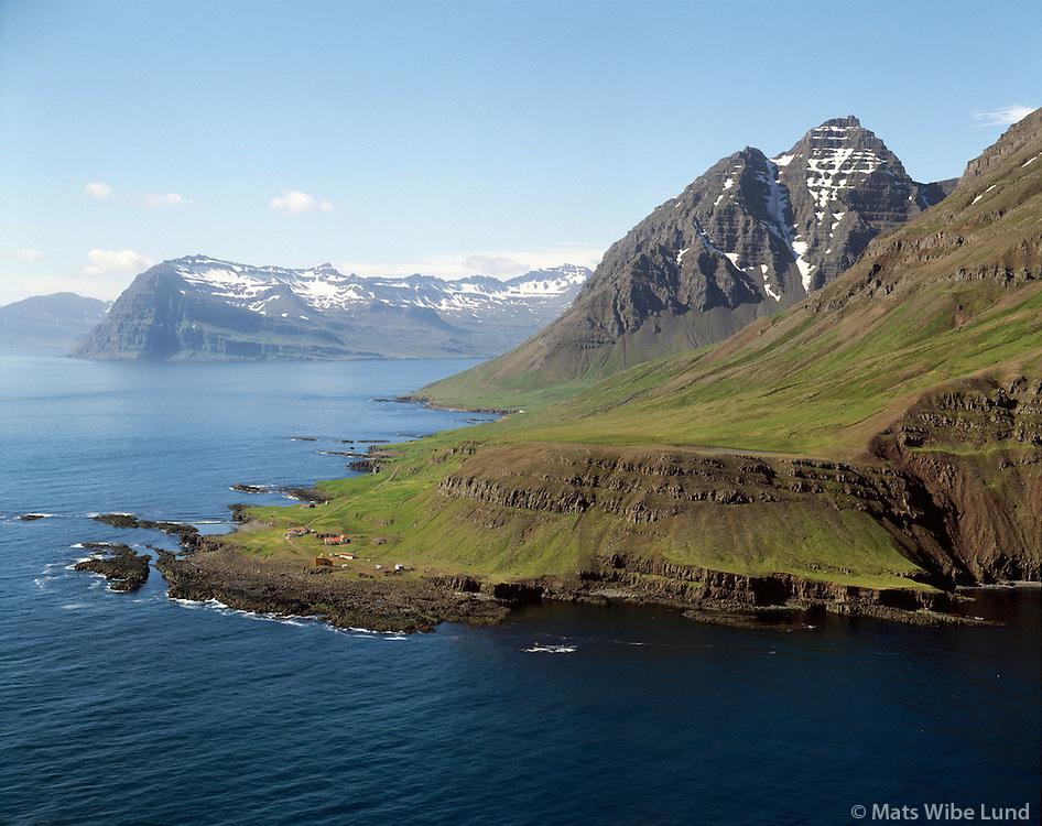 Dalatangi,  Mjóifjörður í bakgrunni. Mjóafjarðarhreppur Loftmynd..Dalatangi lighthouse and met. station. Mjoifjordur in background. Aerial
