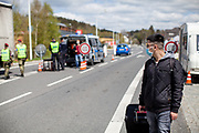 A youg man before crossing the closed state border in between Germany and Czech Republic in Bayerisch Einsenstein after the corona virus outbreak changed our public lifes. Czech Republic is in the state of emergency and just their own citizens or foreigners with a residence permit are allowed to enter.