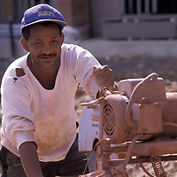 Esquiel Ponce operates a brick saw at the Quaker Hill construction site in Alexandria, Virginia. Release available.