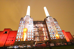 © Licensed to London News Pictures. 25/09/13. LONDON. Firefighters were called to Battersea Power Station after a TV stunt caused concerns the historic building was alight. Flames were projected on to the Grade II*-listed building in south-west London to promote explorer Bear Grylls' new show on the Discovery Channel. Photo credit : Richard Goldschmidt/Piqtured/LNP