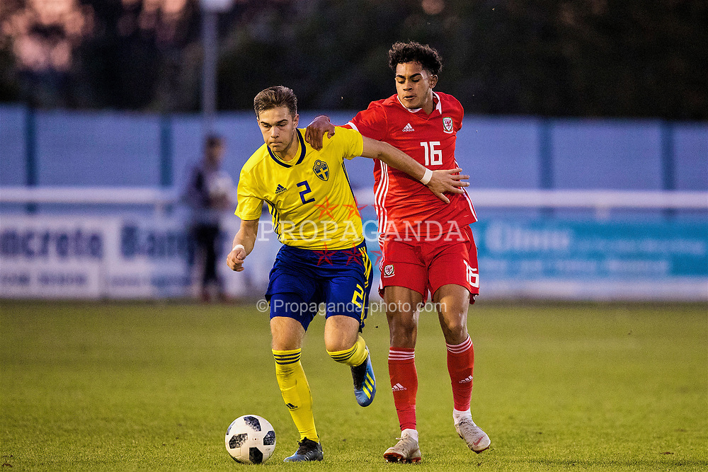 BANGOR, WALES - Saturday, November 17, 2018: Wales' Christian Norton and Sweden's Anton Eriksson during the UEFA Under-19 Championship 2019 Qualifying Group 4 match between Sweden and Wales at the Nantporth Stadium. (Pic by Paul Greenwood/Propaganda)