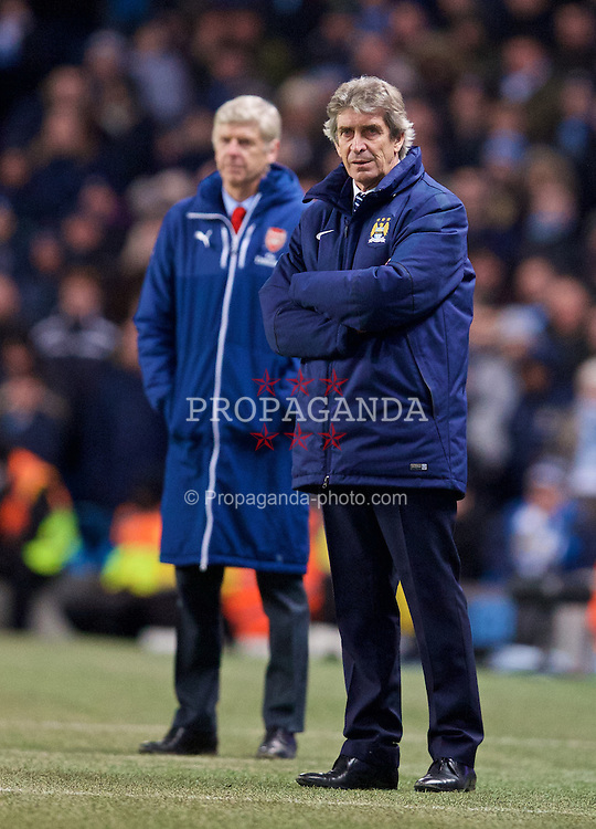 MANCHESTER, ENGLAND - Sunday, January 18, 2015: Manchester City's manager Manuel Pellegrini and Arsenal's manager Arsene Wenger during the Premier League match at the City of Manchester Stadium. (Pic by David Rawcliffe/Propaganda)