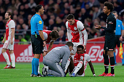 Quincy Promes #11 of Ajax, Dusan Tadic #10 of Ajax, Referee Serder Gozubuyuk and Calvin Stengs #7 of AZ Alkmaar during the Dutch Eredivisie match round 25 between Ajax Amsterdam and AZ Alkmaar at the Johan Cruijff Arena on March 01, 2020 in Amsterdam, Netherlands