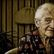PORTRAITS OF SURVIVORS AND IMMIGRANTS <br /> Sobreviviente del Holocausto / Holocaust Survivor<br /> <br /> Sra. Eva Krausz.<br /> <br /> Nació el 17 de junio de 1925 en Pécs, Hungría. Desde muy niña vivió en Budapest. Al formarse el gueto fue llevada a trabajos forzados, pese a haberse casado obligada, creyendo que a las mujeres casadas no se las llevaban. A través de la embajada suiza volvió al gueto y allí esperó la liberación. Gracias al Joint fue a Alemania, después a París y en 1947 a Venezuela.<br /> <br /> Photography by Aaron Sosa<br /> Caracas - Venezuela 2010<br /> (Copyright © Aaron Sosa)