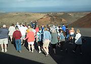 Tourists follow guide Parque Nacional de Timanfaya, national park, Lanzarote, Canary Islands,