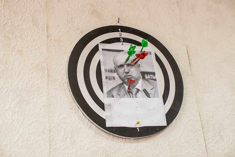 A picture of Oleksandr Turchynov, who was the acting president of Ukraine following the fall of Viktor Yanukovych, on a dart board in the office of a Donetsk People's Republic government official on Friday, April 10, 2015 in Donetsk, Ukraine.