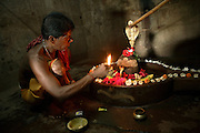 A Baba (Indian Holy Man) is lighting a candle near a Shiva Lingam in the temple of Mukteswar in Bhubaneswar, the capital of Orissa State, India, on Friday, May 16, 2008. Bhubaneswar is also known as the City of Temples as they are widely present in the city. **Italy and China Out**