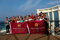 Guangzhou and Shenzhen volunteers of the Parents and Friends of Lesbians and Gays (PFLAG) China organisation pose for group photos on the deck with rainbow coloured scarfs on a cruise in open seas on route back to Shanghai, China, 17 June 2017. About 800 members of the Chinese LGBT (lesbian, gay, bisexual and transgender) community and their parents spent four days on a cruise trip organised by Parents and Friends of Lesbians and Gays (PFLAG) China, a grassroots non-government organisation, celebrating the 10th anniversary of the organisation. It aims to promote coexistence among homosexuals and their families.