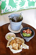 Capella Pedregal's bedside amenity: guacamole, salsa, tortilla chips and beer