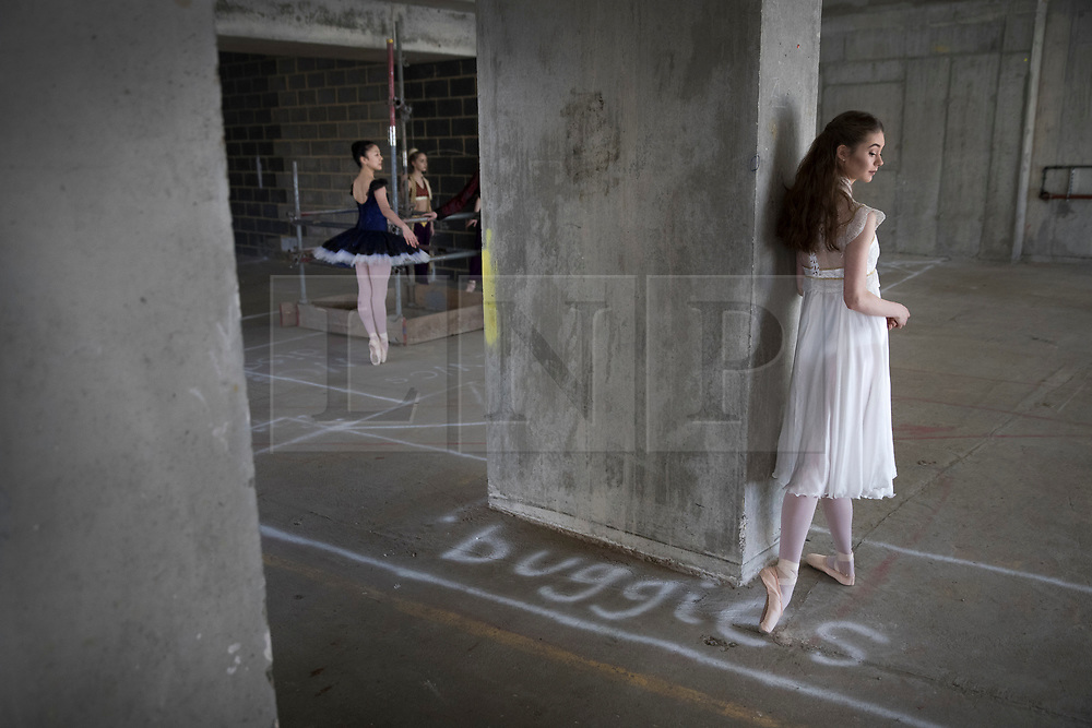 © Licensed to London News Pictures. 21/03/2017. London, UK. Dancer Amy McEntee, 18 (R) stands in The Central School of Ballet's newly announced building in central London. The dancers wear costumes from their forthcoming nationwide Ballet Central tour 2017 against the backdrop of the unfinished interior of the new premises. Photo credit: Peter Macdiarmid/LNP