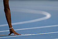 Tomy McQuay's hand on the track before men's 400 meters qualification during the 14th IAAF World Athletics Championships at the Luzhniki stadium in Moscow on August 11, 2013.<br /> <br /> Russian Federation, Moscow, August 11, 2013<br /> <br /> Picture also available in RAW (NEF) or TIFF format on special request.<br /> <br /> For editorial use only. Any commercial or promotional use requires permission.<br /> <br /> Mandatory credit:<br /> Photo by © Adam Nurkiewicz / Mediasport
