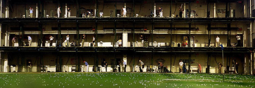 With space at a premium in the vast metropolis of Manhattan, New York City, locals find ways and means for pastime exercise and recreational activities as they go about their daily lives..Practice makes perfectÖThe tiered gold driving range at Chelsea piers on May 5, 2004. Photo Tim Clayton.