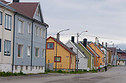 Traditional houses along a street in the city of Vardö in Finnmark county, northern Norway.