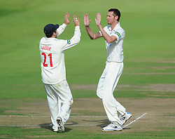 Michael Hogan of Glamorgan celebrates with Andrew Salter after bowling out Benny Howell of Gloucestershire for 40 - Mandatory byline: Dougie Allward/JMP - 07966386802 - 24/09/2015 - Cricket - County Ground -Bristol,England - Gloucestershire CCC v Glamorgan CCC - LV=County Championship - Division Two - Day Three