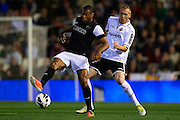 VALENCIA, SPAIN - APRIL 20: (L) Julio Cesar Baptista of Malaga CF   is followed by (R) Jeremy Mathieu of Valencia CF during the Liga BBVA between Valencia CF and Malaga CF at the Mestalla stadium on April 20, 2013 in Valencia, Spain. (Photo by Aitor Alcalde Colomer).
