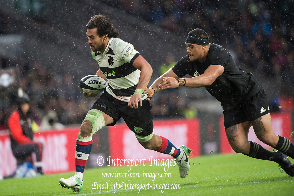 Twickenham, Surrey. England.  Baa Baa's Vaea FIFITA, breaking away from All Black. Atu MOLI, during the Killik Cup, Barbarians vs New Zealand. Twickenham. UK<br /> <br /> Saturday  04.11.17<br /> <br /> [Mandatory Credit Peter SPURRIER/Intersport Images]