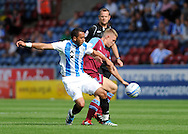 Picture by Graham Crowther/Focus Images Ltd. 07763140036.10/9/11 .Anton Robinson of Huddersfield battles with Max Parker of Tranmere during the Npower League 1 game at the Galpharm Stadium, Huddersfield.