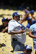 LOS ANGELES, CA - JULY 13:  A fan walks to his seat before the Los Angeles Dodgers game against the San Diego Padres at Dodger Stadium on Sunday, July 13, 2014 in Los Angeles, California. The Dodgers won the game 1-0. (Photo by Paul Spinelli/MLB Photos via Getty Images)