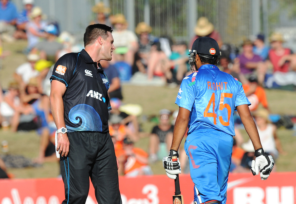 New Zealand's Mitchell McClenaghan, left, offers India's Rohit Sharma some batting advice in the first one day International cricket match, McLean Park, New Zealand, Sunday, January 19, 2014. Credit:SNPA / Ross Setford