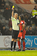 Sandro Semedo (22) of Leyton Orient  is shown a yellow card by referee Christopher Sarginson during the EFL Sky Bet League 2 match between Plymouth Argyle and Leyton Orient at Home Park, Plymouth, England on 14 February 2017. Photo by Graham Hunt.