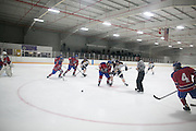 Victor and Fairport players scramble for a loose puck during a scrimmage at Thomas Creek in Fairport on Monday, November 24, 2014.