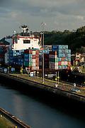 Cargo ship leaving Miraflores Locks heading to the Pacific ocean. Panama Canal, Panama City, Panama, Central America.