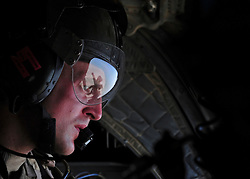 © Licensed to London News Pictures. 17/01/12. FILE PICTURE The MOD has announced Up to 2,900 Army, 1,000 RAF and 300 Royal Navy staff to be made redundant in latest UK defence cuts. Sgt Alex Stayling is a part of the RAF Aircrew team that man the chinook.  As he prepares the helicopter to land he checks the area to ensure that the landing site is safe from enemy fire. The RAF Regiment's Medical Emergency Response Team (MERT) is made up of two teams based in 'Main Operating Base Bastion', they are responsible for extracting casualties from anywhere within Helmand Province.  The MERT consists of a doctor, an emergency department nurse and two paramedics.  In addition four Royal Air Force Regiment gunners provide armed protection when they land and leave the helicopter to collect the casualty.   Caption must read Alison Baskerville/LNP...