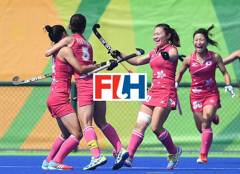 Japan's Emi Nishikori (L) celebrates scoring a goal with teammates during the women's field hockey Japan vs India match of the Rio 2016 Olympics Games at the Olympic Hockey Centre in Rio de Janeiro on August, 7 2016. / AFP / MANAN VATSYAYANA        (Photo credit should read MANAN VATSYAYANA/AFP/Getty Images)