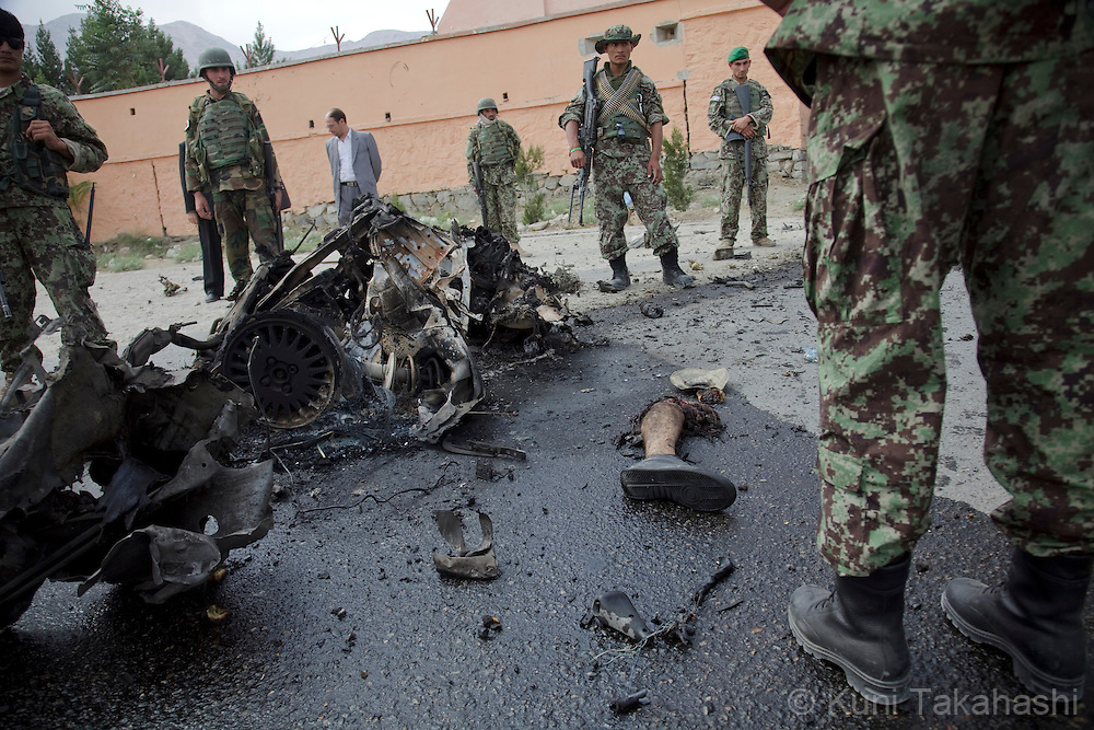 A leg of a suicide bomber is left next to debris of a car at the scene in CHAHARIKAR, Parwan Province, 50km northwest of Kabul, Afghanistan on Aug 14, 2011. Six suicide bombers attacked the provincial governor's compound, allegedly killed 20. .(Photo by Kuni Takahashi) .