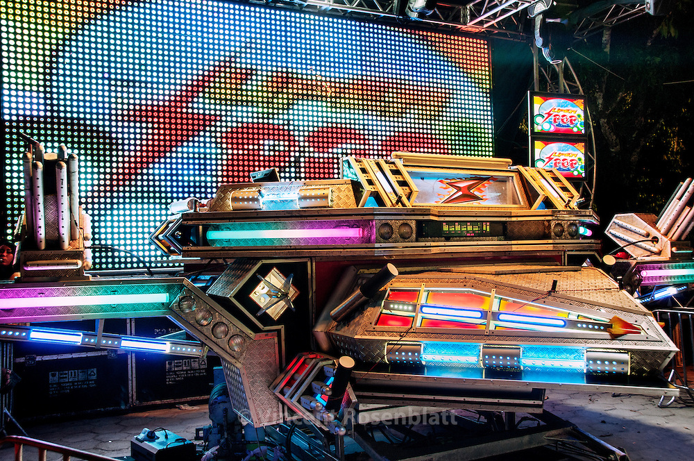 """Superpop, """"the fire eagle, the crowd pusher"""", one of the biggest machines in Belem. In the middle of the night, the fire eagle will take off graciously thanks to its hydraulic system and shoots its fireworks and lasers, in a pyrotechnic show at the edge of technology.."""