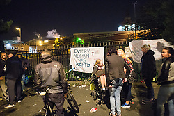 © Licensed to London News Pictures . 16/09/2015. Manchester, UK . Scene on Bury New Road , outside HMP Manchester (formerly Strangeways Prison ) where protesters are blocking the road , playing music and dancing in the road as Stuart Horner continues his protest on the roof of HMP Manchester . Photo credit : Joel Goodman/LNP