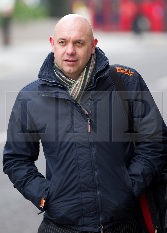© Licensed to London News Pictures. 27/03/2013. London, UK. Ex-Surrey police officer officer Alan Tierney, who admitted misconduct in public office after selling information about the mother of footballer John Terry's mother and Rolling Stone band member Ronnie Wood to the Sun newspaper, arrives at the Old Bailey In London today (27/03/2013). Photo credit: Matt Cetti-Roberts/LNP