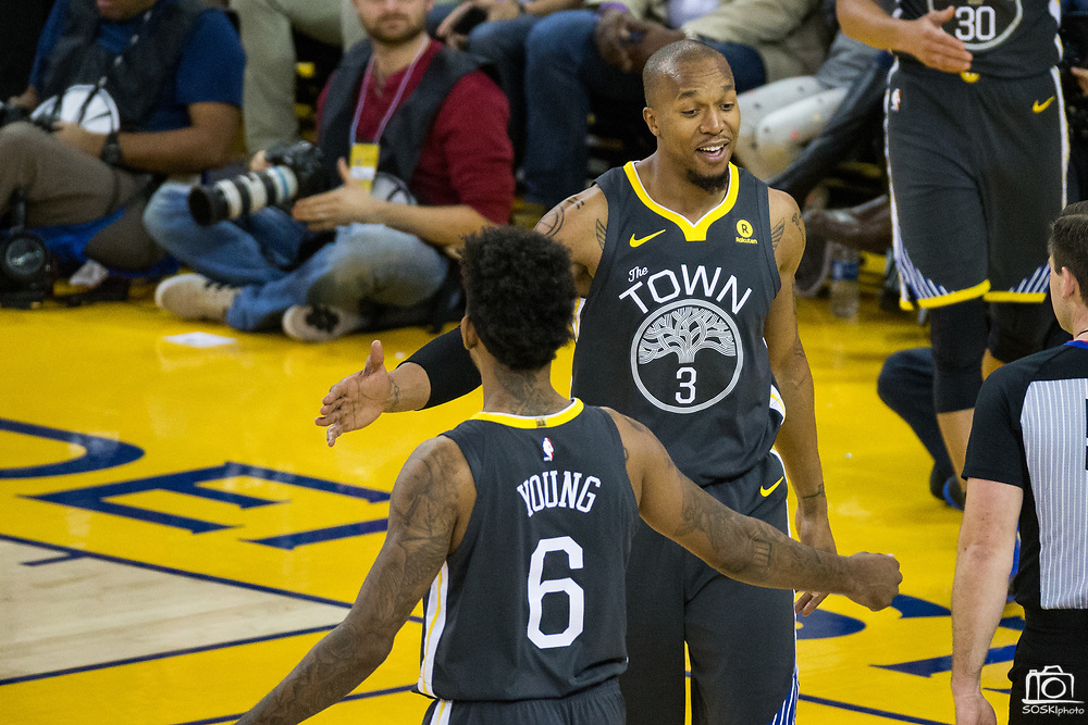 Golden State Warriors forward David West (3) celebrates with Golden State Warriors guard Nick Young (6) during a NBA game against the LA Clippers at Oracle Arena in Oakland, California, on February 22, 2018. (Stan Olszewski/Special to S.F. Examiner)