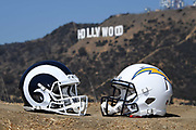 General overall view of Los Angeles Chargers (left) and Los Angeles Rams helmets with the Hollywood sign and Mount Lee as a backdrop in Los Angeles, Wednesday, Sept. 19, 2018. After more than two decades without an NFL team, the Rams relocated from St. Louis in 2016 and the Chargers moved in 2017. The teams will share a stadium financed by Rams owner Stan Kroenke at the LA Stadium and Entertainment District in Inglewood, Calif. scheduled to be completed in 2020.
