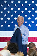 Former Vice President Joe Biden picks up his suit jacket at the conclusion of a town hall meeting at the International Longshoreman's Association Hall July 7, 2019 in Charleston, South Carolina.