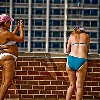 Two middle aged women wearing bikinis