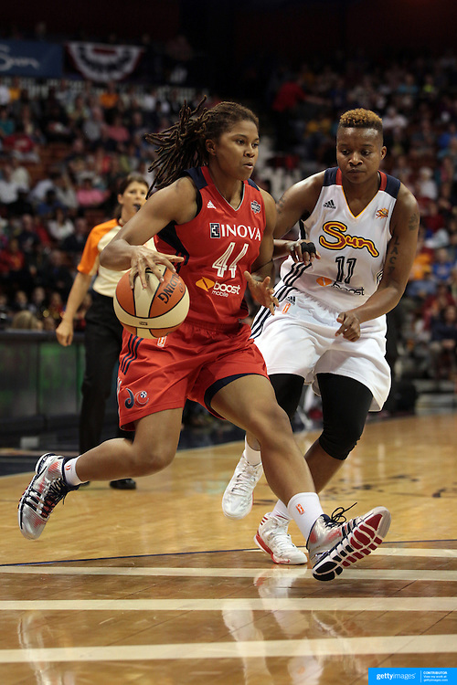 Tierra Ruffin-Pratt, Washington Mystics, drives past Natasha Lacy, Connecticut Sun, during the Connecticut Sun V Washington Mystics WNBA regular season game at Mohegan Sun Arena, Uncasville, Connecticut, USA. 7th June 2013. Photo Tim Clayton