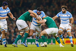 Argentina Prop Ramiro Herrera is tackled by Ireland Lock Iain Henderson and Prop Cian Healy - Mandatory byline: Rogan Thomson/JMP - 07966 386802 - 18/10/2015 - RUGBY UNION - Millennium Stadium - Cardiff, Wales - Ireland v Argentina - Rugby World Cup 2015 Quarter Finals.