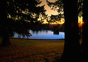 Sun sets over Reservoir 5, one of three open reservoirs at Mt Tabor Park and of five total in Portland.  The 3 open reservoirs in Mount Tabor Park were placed in the National Register of Historic Places on January 15, 2004.  Environmental Protection Agency (EPA) regulation: Long Term 2 Enhanced Surface Water Treatment Rule, referred to as the LT2 rule imposes new requirements that open water reservoirs be covered, buried or additionally treated.  This applies to Portland's five open reservoirs and to the unfiltered Bull Run sourse supplying them.  Photo: September 2004.  Nikon F4, 20-35/2.8D.  Kodak E100VS