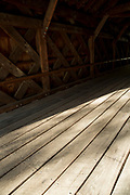 Timber planks of wooden floor and beams of The Old Covered Bridge, also known as Upper Sheffield Covered bridge by Sheffield Plain, Massachusetts
