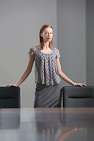 Businesswoman standing in conference room portrait