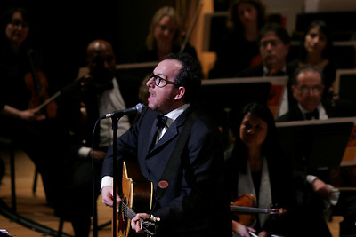 Elvis Costello performing with The Brooklyn Philharmonic  on May 12th 2006. .Steve Nieve joined on piano for part of the show. Conducted by Alan Broadbent.