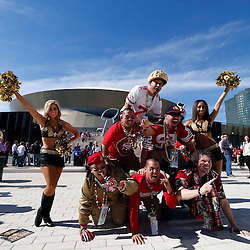 Feb 3, 2013; New Orleans, LA, USA; San Francisco 49ers fans from top, left to right, including Jordan Valdry , Mikie Harrington , Andre Lavallier , Frankie Harrington , Johnny Harrington and Jeremy Vukasinovic form a human pyramid outside before Super Bowl XLVII against the Baltimore Ravens at the Mercedes-Benz Superdome. Mandatory Credit: Derick E. Hingle-USA TODAY Sports